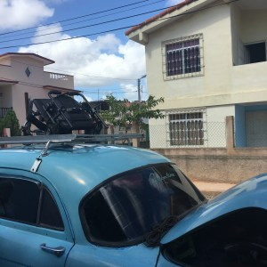 wheelchair on top of old car in Havana