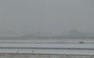 Beijing airport snowing - feature image