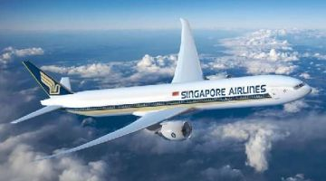 Singapore Airlines Airbus flying in blue sky with clouds