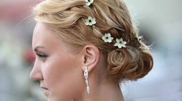 girl with golden brown hairs and flower pins side pose