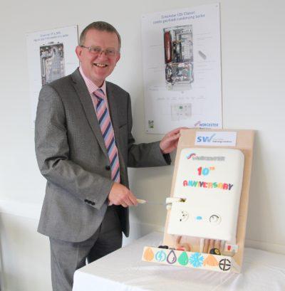 Martyn Bridges cuts the cake