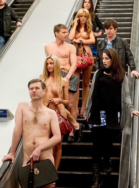 Baring all: Naked workers attract stares from other commuters as they travel on the London Underground