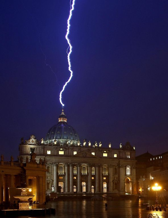 A lighting strikes the basilica of St.Peter's dome during a storm