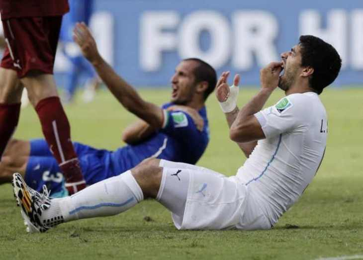 during-the-world-cup-uruguays-luis-suarez-was-caught-biting-the-shoulder-of-italys-giorgio-chiellini-during-the-countries-final-game-in-the-group-stage-suarez-was-banned-from-nine-international-games-by-fif-75