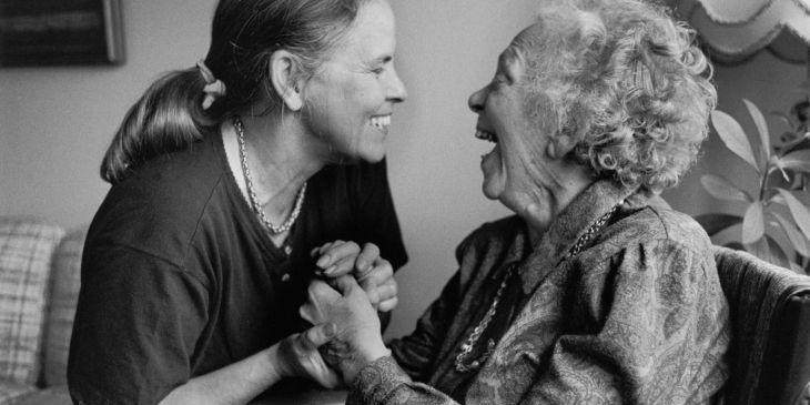 A daughter with her elderly mother who is sick with Alzheimer