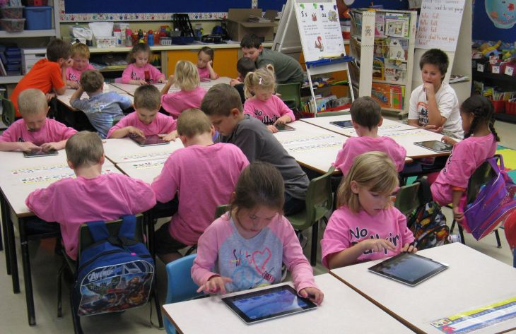 Students at Joseph Giles Elementary School in Dartmouth, N.S., use the tablets they won in the Staples' 2011-2012 Recycle for Education Computer Lab Contest (CNW Group/Staples Canada Inc.)