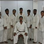 CCS Karate team with coach