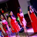 Students singing Christmas carols at the Noel Ensemble Christmas party held on December, 2015