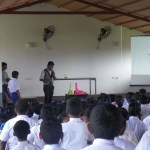 Performing a chemistry magic show at a school.