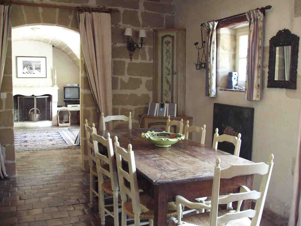 Enchanting Wall Lamp on Stone Wall for Traditional Dining Area with Oak Farmhouse Style Furniture