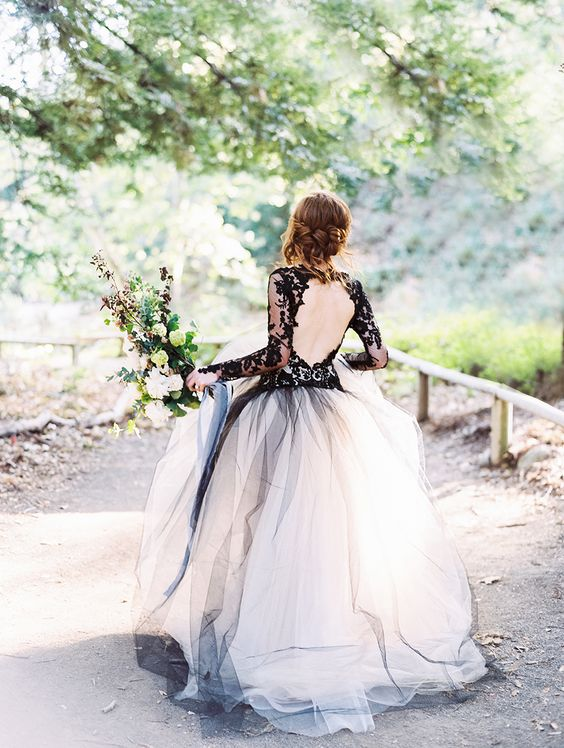 A black lace bodice contrasts beautiful with the full, white tulle skirt, don't you think?
