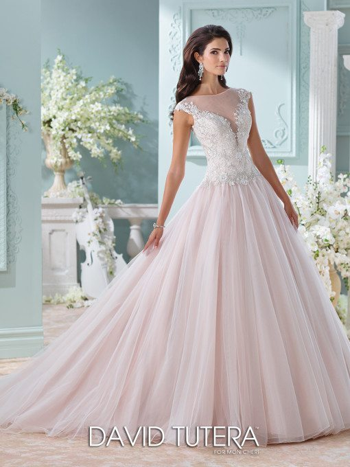 Feel like the ultimate princess in this blushing ball gown that's more than fit to wow your guests as you walk down the aisle.