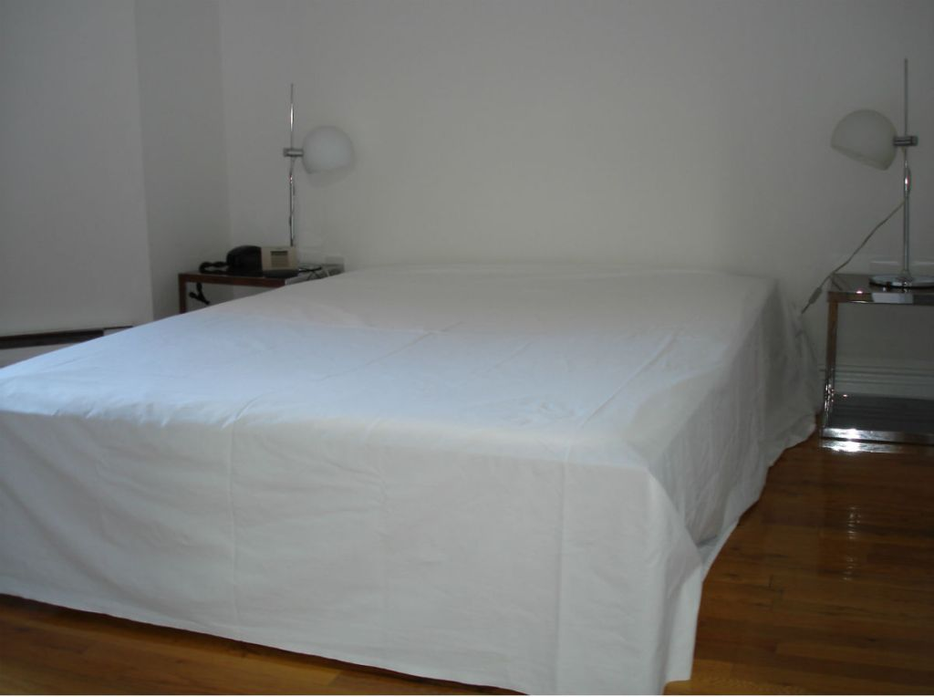 Bed with flat sheet as bed skirt