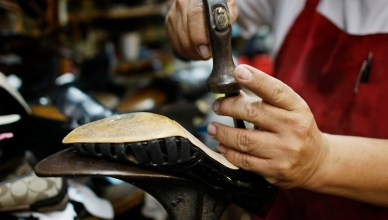 SURFSIDE, FL- NOVEMBER 18:  Nicholas Cammarata works on repairing a shoe at Adams Shoe Service Shop November 18, 2008 in Surfside, Florida. Store owner Tina Cammarata say's she has seen an uptick in people bringing shoes in for repair. As the economy continues to falter people are trying to save money by turning to repair shops instead of spending the extra money it might cost to replace a broken item.  (Photo by Joe Raedle/Getty Images)