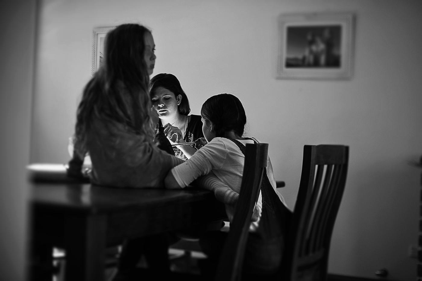 Lifestyle photography sydney- girls sitting at table.