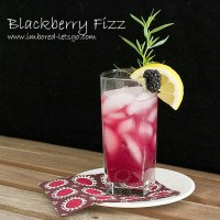 A refreshing cocktail with blackberry tarragon syrup