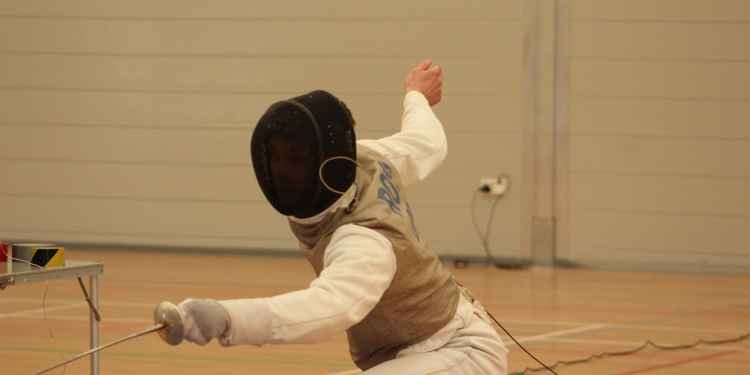 Will Ross shows his skill in the foil fencing competition.