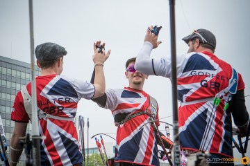 Kieran Slater, Patrick Huston and Larry Godrey celebrate during the European Archery Championship