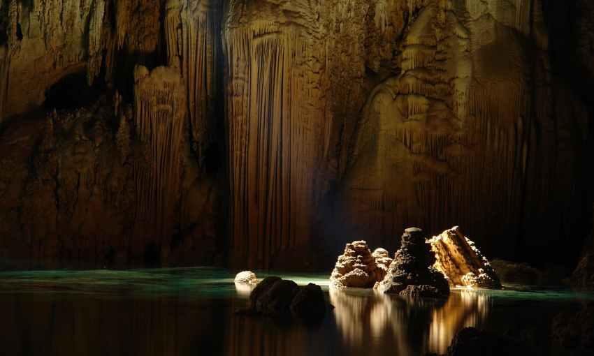 limestone stalagmites inside the Anhumas Abyss, Brasil. — Photo by Caio Vilela