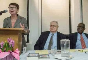 Socialist Workers Party presidential candidate Alyson Kennedy speaks at NY forum March 25. From left, Norton Sandler, chair, and Osborne Hart, SWP candidate for vice president.