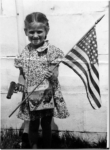 Girl with flag and gun
