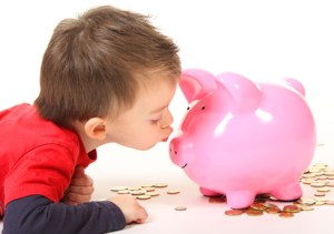Kissing a piggy shaped bank; love your money