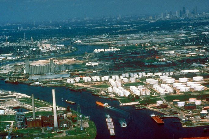 Aerial view of a small section of the Houston Ship Channel on Buffalo Bayou, which leads upstream directly into the city of Houston, Texas, USA. The downtown section of Houston can be seen at upper right. The city of Galena Park, Texas is at center right in this photograph. The U.S. Army Corps of Engineers dredges and maintains the channel for deepwater shipping. View is to the west. - U.S. Army Corps of Engineers Digital Visual Library