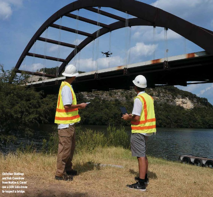Christian Stallings and Rob Crawshaw from McKim & Creed use a 3DR Solo drone to inspect a bridge.  -  COURTESY OF MCKIM & CREED