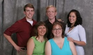 Above, a Steele family photo. At left in the back row is Edgar's son Rex next to Edgar. In the front are, from left to right, Cyndi Steele, daughter Nicole and, at far right, daughter Kelsey.