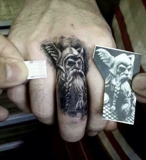 finger tattoo of odin