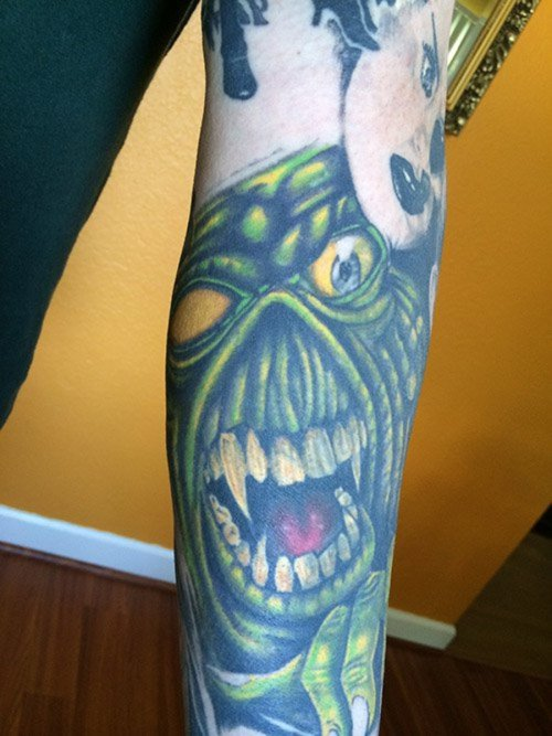 Eddie coverup tattoo by Corey Reed.