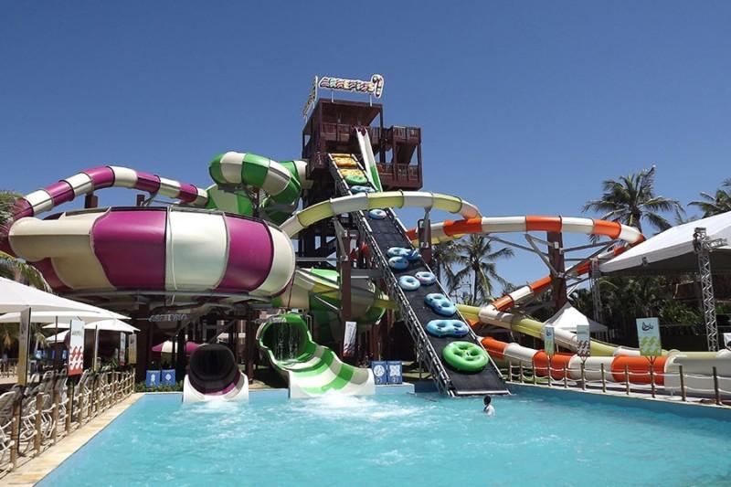 custom-complex-five-rides-beach-park-arrepius-aquiraz-brazil-green-white-purple-orange-yellow