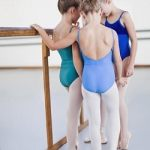 Ballet dancers talking in studio
