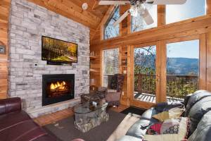The interior of a Gatlinburg cabin with a stone fireplace.