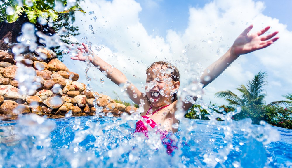 little girl splashing at at a pool in Gatlinburg