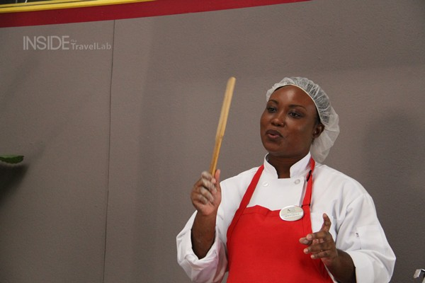 Bajan Recipe waving a cou cou stick