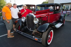 (L-R) Willy Segarra, from Hackettstown, and Glenn Nemeth, from Roxbury, talk with John Stasyshyn, from Hampton, about John's 1930 Model A, which, according to John, is the oldest, original hot rod in Warren and Hunterdon counties.