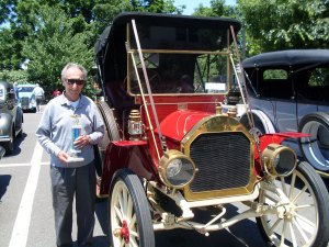 Bernard Peach, of Port Murray, shows off his 1908 Stauer Motor Car. winner of oldest car.