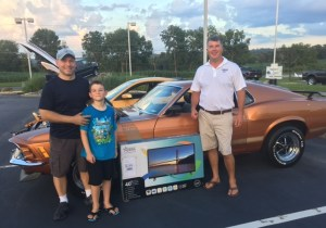 The Owner's Choice winner, left, pictured with John Smith, took home a new TV.