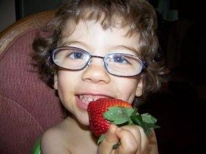Tristan and a big strawberry