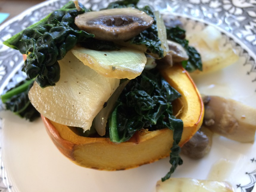 Research shows that vegan diets can lower food-based greenhouse gas emissions by 70%. This is one of the simple vegan recipes from our book, Food of Love: roasted delicata squash with kale-mushroom saute.