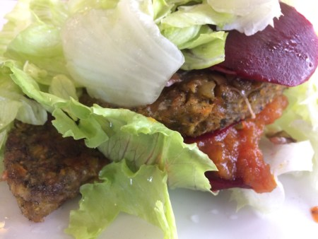 The poor have impaired access to fresh foods, and are less able to fight obesity with healthy organic food options like this plant-based burger wrapped in lettuce.
