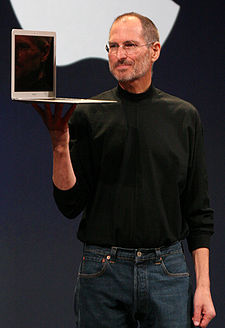 Jobs holding a MacBook Air at Macworld Conference & Expo 2008
