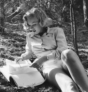 Marilyn Monroe reading in the woods