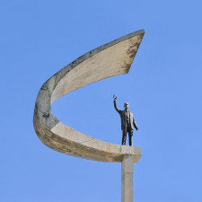 Statue of Juscelino Kubitschek in front of the JK Memorial in Brasília, Brazil. The statue, which is by Honório Peçanha, is 4.5 m high and weighs 1500 kg. - Brazilian wealth