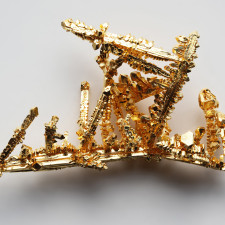 Synthetic made gold crystals by the chemical transport reaction in chlorine gas. Purity >99.99%