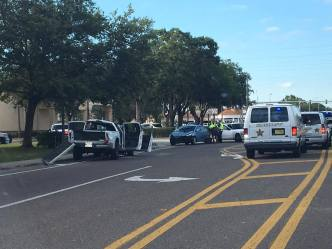 Investigators onscene of rollover crash on Forest Lakes Blvd south of Tampa Road