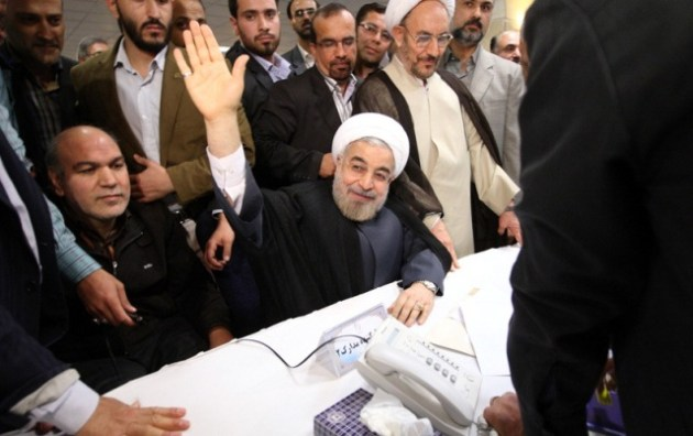 Hassan Rohani, one of leading reformists candidates waving hands to journalists.