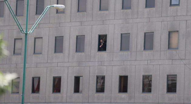 Iranian security officer is seen inside the Parliament building.