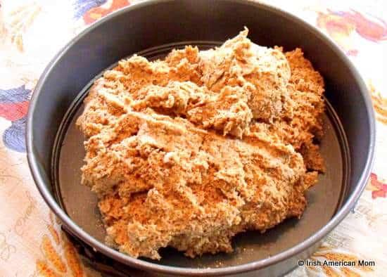 Brown bread dough transferred to a baking pan